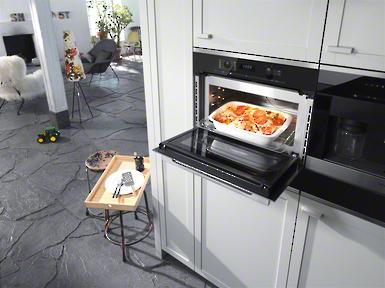 H 6100 BM - Piekarnik z kuchnią mikrofalową z zegarem elektronicznym i programami Combi dla szybkich, idealnych rezultatów.--